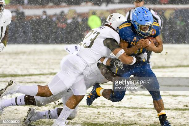 Navy Midshipmen quarterback Malcolm Perry recovers an errant snap and runs for a first down in the fourth quarter against Army Black Knights...