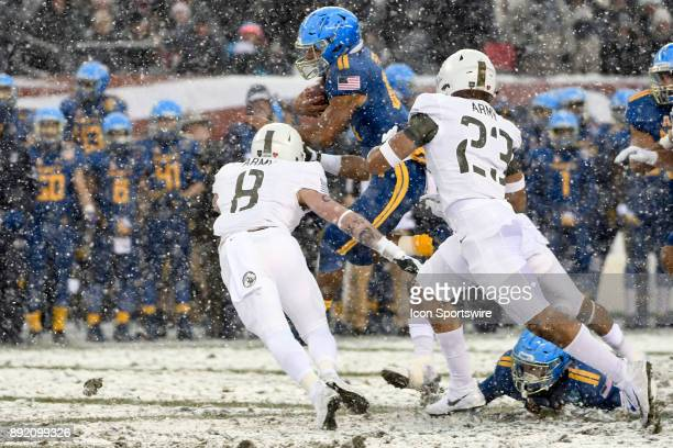 Navy Midshipmen quarterback Malcolm Perry runs the ball against Army Black Knights defensive back Rhyan England and defensive back Elijah Riley on...