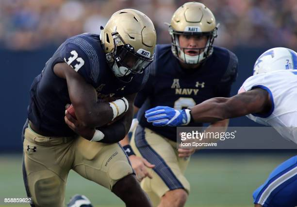 Navy Midshipmen quarterback Zach Abey hands the ball off to Navy Midshipmen fullback Chris High during a match between Navy and Air Force on October...