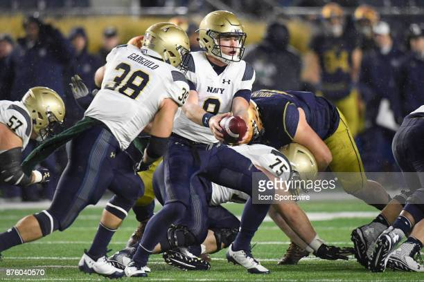 Navy Midshipmen quarterback Zach Abey looks to hand off the football to Navy Midshipmen fullback Anthony Gargiulo during the college football game...