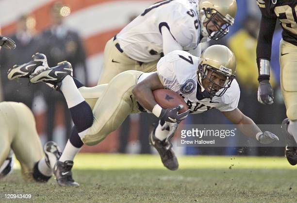 Navy Midshipmen running back Reggie Campbell leaps for yards Saturday December 3 2005 at Lincoln Financial Field in Philadelphia PA