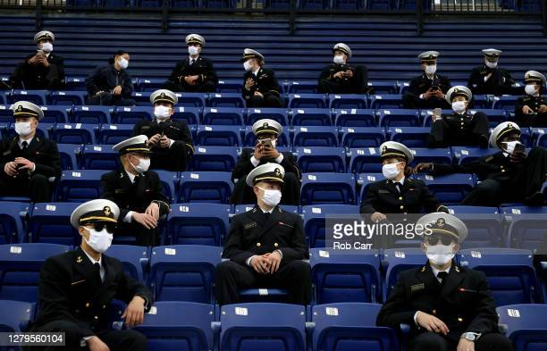 Navy Midshipmen wait for the game between Navy and the Temple Owls to start at Navy-Marine Corps Memorial Stadium on October 10, 2020 in Annapolis,...
