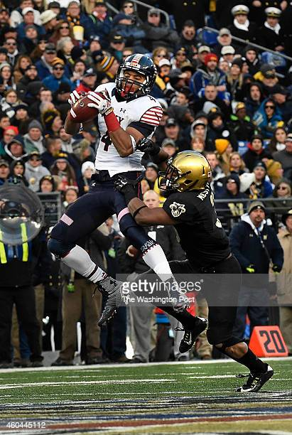 Navy Midshipmen wide receiver Jamir Tillman makes a catch in front of Army Black Knights defensive back Josh Jenkins for a 35yard gain during the...