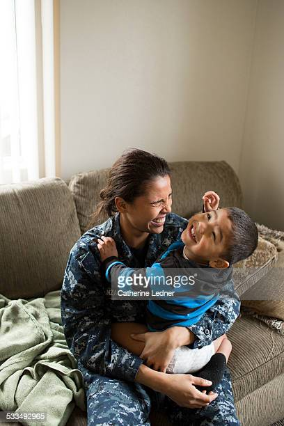 Navy mom laughing with young son