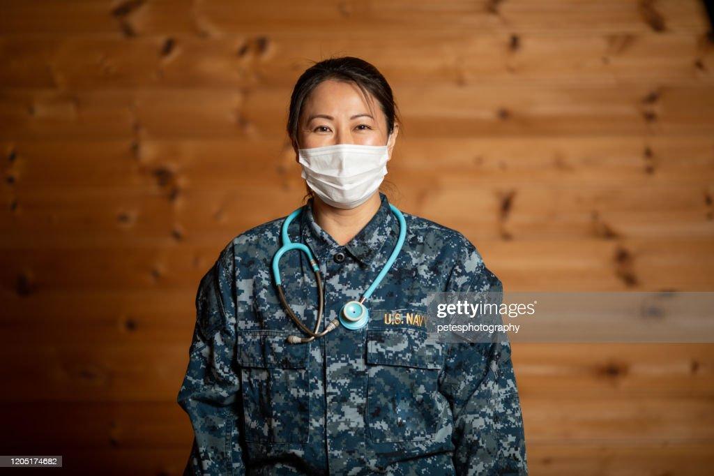 Navy nurse with stethoscope portrait : Stock Photo