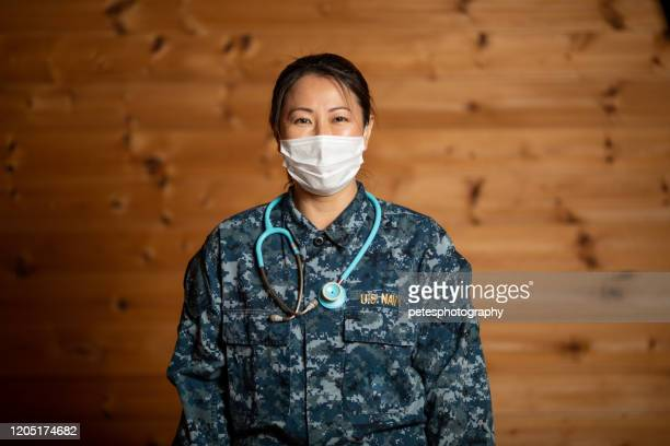 navy nurse with stethoscope portrait - us navy stock pictures, royalty-free photos & images