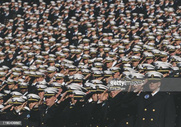 Navy Officer Cadets from the United States Naval Academy at Annapolis salute before the NCAA Division 1 A ArmyNavy college football game on 4th...