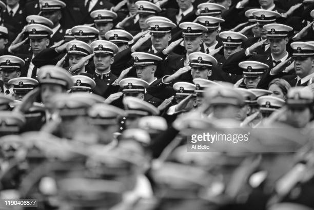 Navy Officer Cadets from the United States Naval Academy at Annapolis salute before the NCAA Division 1A ArmyNavy college football game on 4th...