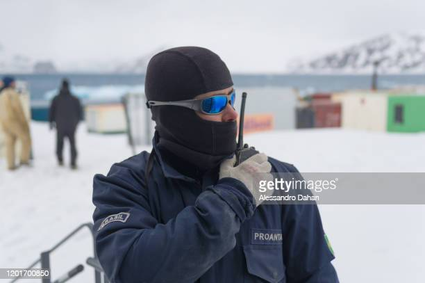 Navy officer supporting the ceremonial production team on November 05 2019 in King George Island Antarctica