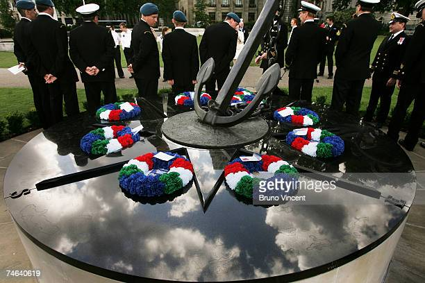 Navy officers gather at the Merchant Navy Falklands War Memorial in Trinity Gardens after a sunset ceremony on June 15 2007 in London Commemorations...