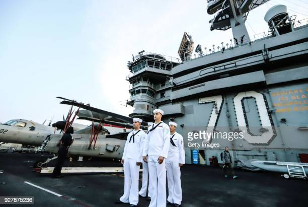S Navy officers on duty onboard the USS Carl Vinson aircraft carrier at Tien Sa Port on March 5 2018 in Danang Vietnam A United States aircraft...
