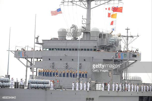Navy officers stand on the US lead ship USS Blue Ridge on August 5 2014 in Qingdao Shandong province of China The command ship of the United States...