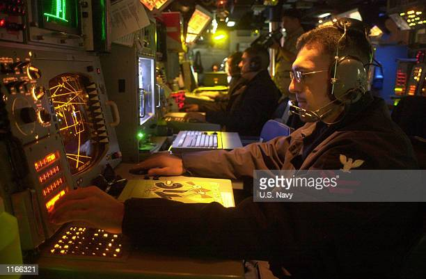 Navy operations specialist works the Tactical Data Coordinator watch October 7, 2001 aboard the USS Princeton. The USS Princeton is performing tasks...