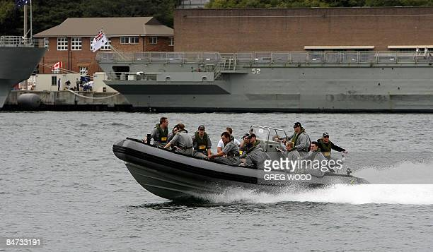 Navy Personnel leave Woolloomooloo Bay near the Garden Island Naval Base on Sydney Harbour on February 11 2009 An Australian navy diver was seriously...