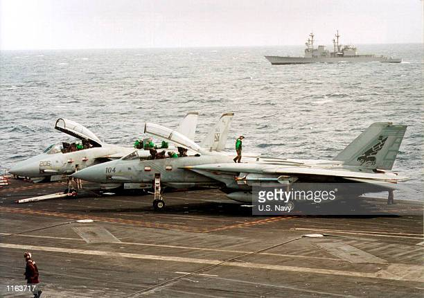 Navy personnel perform maintenance on two F14 aircraft September 16 2001 aboard the USS John F Kennedy The Navy is stepping up it's presence in the...