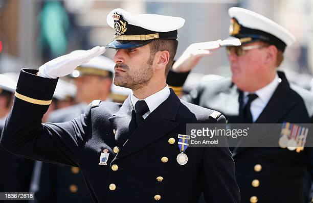 Navy personnel salute the GovernorGeneral as they march down George Street on October 9 2013 in Sydney Australia Over 4000 personnel paraded through...