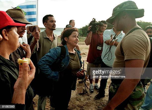 Navy Personnel Talk With Nilsa Median June 1 As She And 26 Demonstrators Trespassed Restricted Military Grounds At Camp Garcia Naval Base In The...
