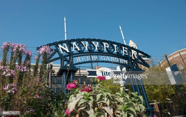 navy pier beer garden entrance sign with colorful flower landscape - navy pier stock pictures, royalty-free photos & images