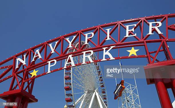 navy pier entrance sign, chicago, illinois - navy pier stock pictures, royalty-free photos & images