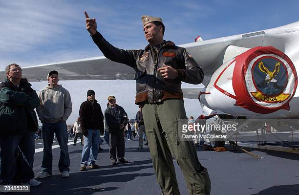 Navy pilot Mark Gonzalez explains to visitors what it's like to take off and land on the deck of the USS John F Kennedy March 3 2007 during a last...