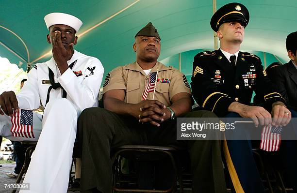 US Navy Pretty Officer 3rd Class Reginald Cherubin from Haiti who has served in a combat mission in Afghanistan Marine Gunnery Sgt Brian Berthland...