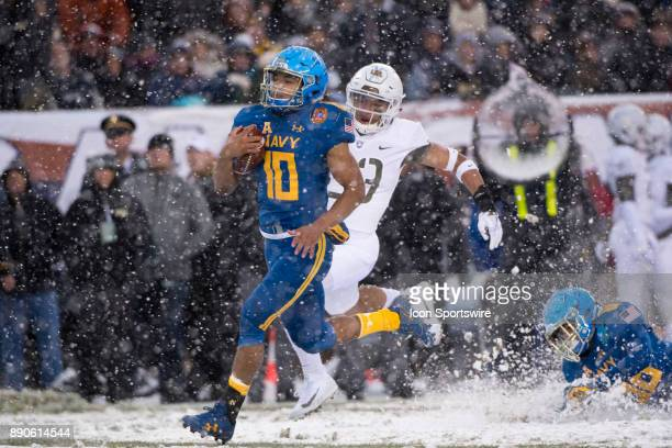 Navy QB Malcolm Perry dashes past Army DB Elijah Riley for a Touchdown in the first half during the game between The Army Black Knights and Navy...