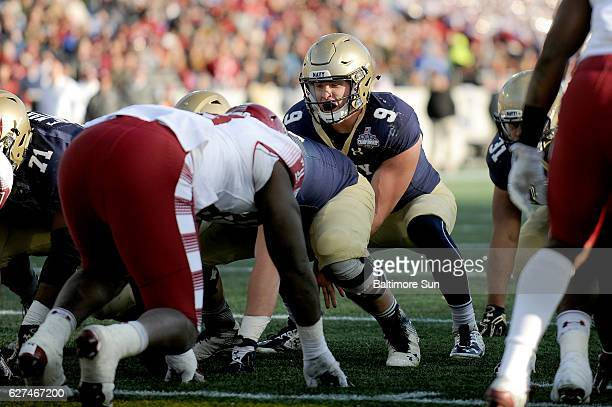 Navy quarterback Zach Abey takes a snap in the third quarter against Temple in the American Athletic Conference championship game at NavyMarine Corps...