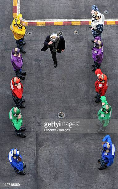 U.S. Navy rainbow sideboys stationed aboard aircraft carrier USS Abraham Lincoln.