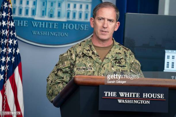 Navy Rear Adm. John Polowczyk, supply chain task force lead at the Federal Emergency Management Agency, speaks during a press briefing with members...