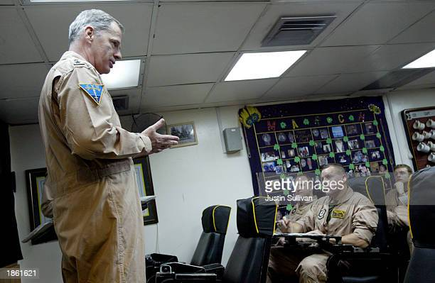 S Navy Rear Admiral Rear Admiral Barry Costello briefs pilots from the VFA151 Vigilantes squadron aboard the USS Constellation as they prepare to...
