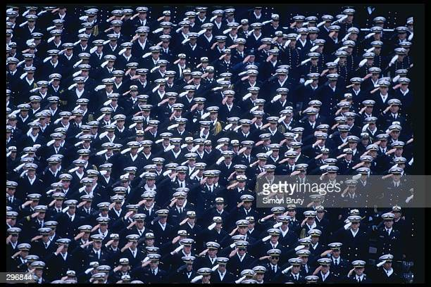 Navy recruits salute the flag during a game between the Army Black Knights and the Navy Midshippmen at Veterans Stadium in Philadelphia Pennsylvania...