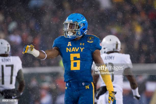 Navy Safety Sean Williams calls out to a teammate between plays in the second half during the game between The Army Black Knights and Navy Midshipmen...
