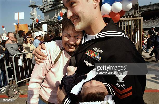 Navy Sailor Mauricio Andre hugs his Mother Mary Lou while holding his daughter Gabriella,7 weeks after the USS Nimitz returned to North Island Naval...