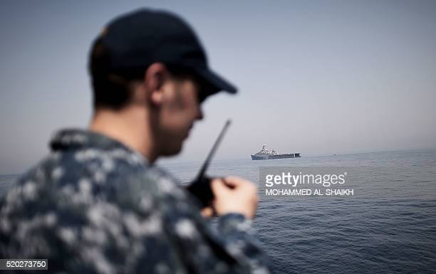 Navy sailor takes part in multinational training exercises aboard the USS Ponce in the Gulf off the coast of Bahrain's capital Manama on April 10...