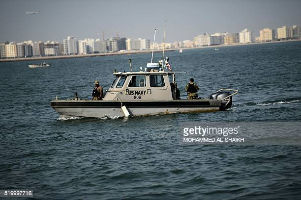 US Navy sailors drive a boat on April 9 2016 during the International Mine Countermeasures Exercise organised by the US Navy at its Naval Support...