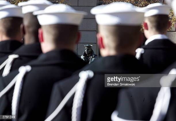 S Navy sailors form a ceremonial guard at a wreathlaying ceremony to memorialize the victims of the attack on Pearl Harbor and pay tribute to the...