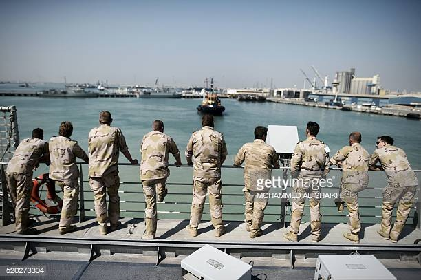 Navy sailors from The Netherlands watch training exercises from aboard the Choctaw County a new US Navy noncombatant vessel that has a civilian crew...