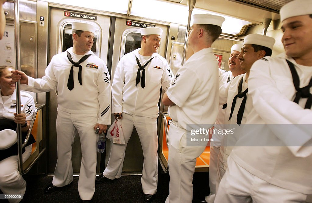 US Navy sailors from the USS John F. Kennedy ride on the subway during Fleet Week May 27, 2005 in New York City. Fleet Week honors American servicemen and runs through Memorial Day.
