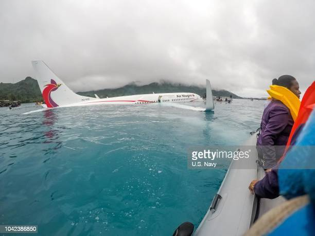 S Navy Sailors from Underwater Construction Team 2 assist local authorities in shuttling the passengers and crew of Air Niugini flight PX56 to shore...