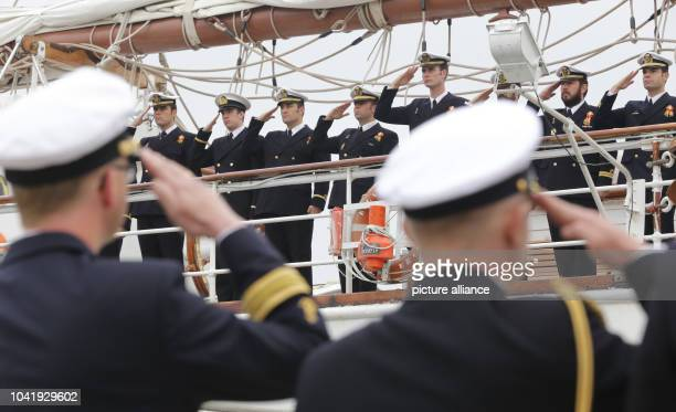 Navy sailors have lined up on and in front of training ship Juan Sebastian de Elcano of the Spanish navy in Hamburg Germany 19 June 2014 The navy...