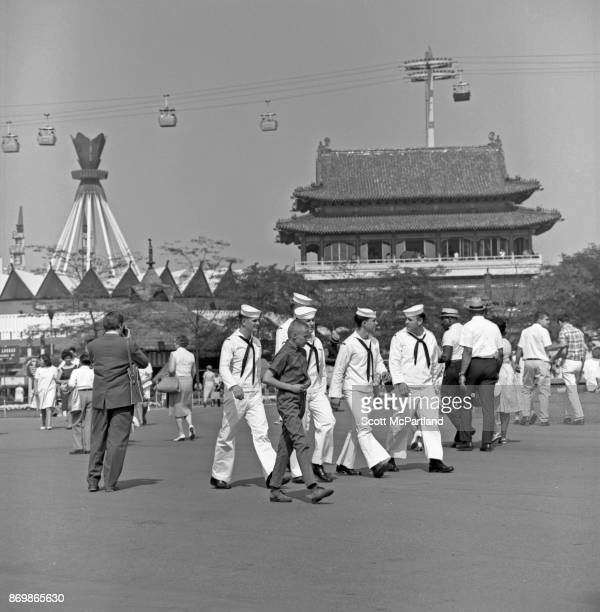 Navy sailors in uniform walk around and take in the sights at the 196465 World's Fair in Flushing Meadows Corona Park New York New York June 12 1965...