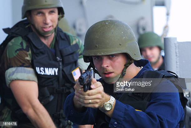 Navy sailors practice a security drill aboard the USS Mount Whitney February 26, 2003 in the Gulf of Aden off the coast of Djibouti. The USS Mount...