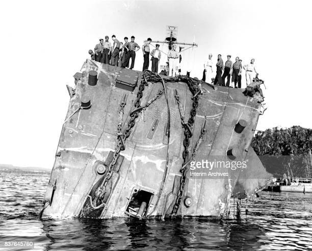 US Navy sailors stand atop the collapsed bow of the USS Honolulu Tulagi Solomon Islands July 20 1943 The vessel which sufferd torpedo damage during...