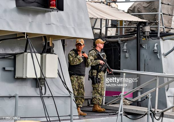 Navy sailors stand guard aboard the USS Sirocco patrol ship while docked at the US 5th Fleet Command in Bahrain's capital Manama on December 17, 2019.