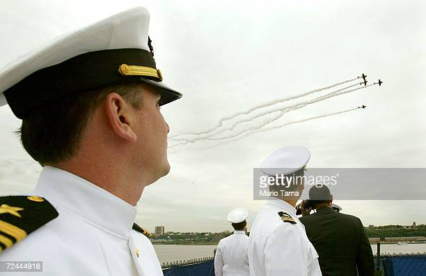 S Navy sailors watch jets fly in a Missing Man formation at the Intrepid Sea Air Space Museum Memorial Day Ceremony May 31 2004 in New York City...