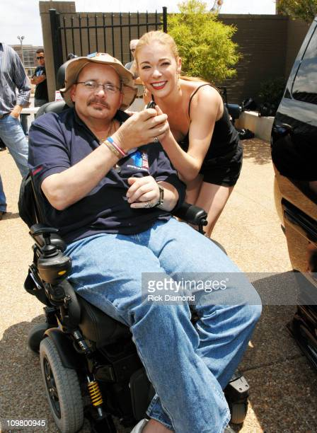Navy SeaBee Peter Reid and LeAnn Rimes during CMA Music Festival Fan Fair 2007 Leann Rimes Presents Severely Wounded Veteran Of Iraq War And His...