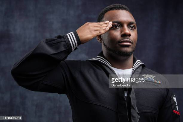 us navy seabee service member - saluting stock pictures, royalty-free photos & images