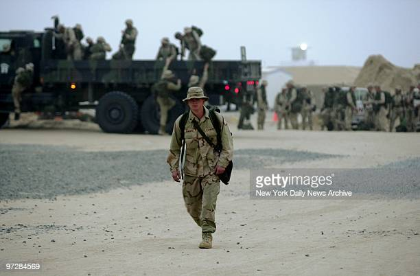 Navy Seabees at Al Jaber Air Base in the Kuwaiti desert prepare to move on to a new position American troops and equipment are massed in Kuwait in...