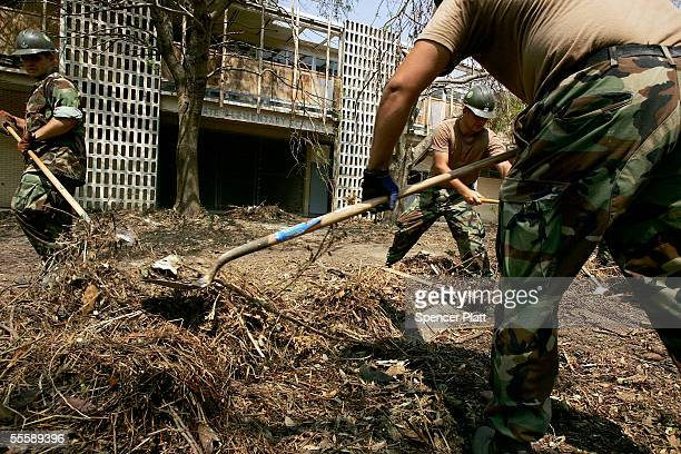 Navy Seabees based out of Norfolk Virginia clean the yard of an elementary school of debris from of Hurricane Katrina September 14 2005 in Biloxi...