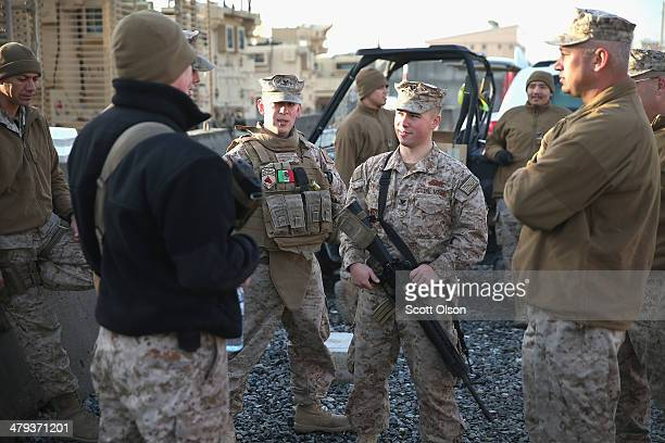 S Navy Seabees from Naval Mobile Construction Battalion 28 listen to a mission brief before heading out to train soldiers with the Afghan National...